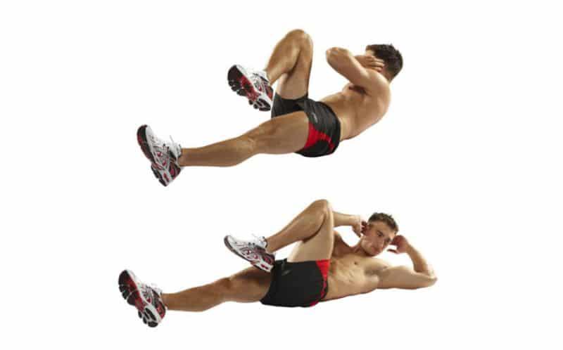 Gập bụng đạp xe là một trong các bài tập gym cho nam giúp xây dựng cơ bụng